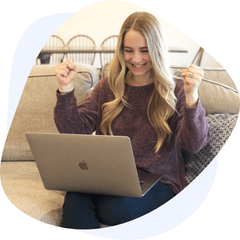 blonde woman celebrating laptop