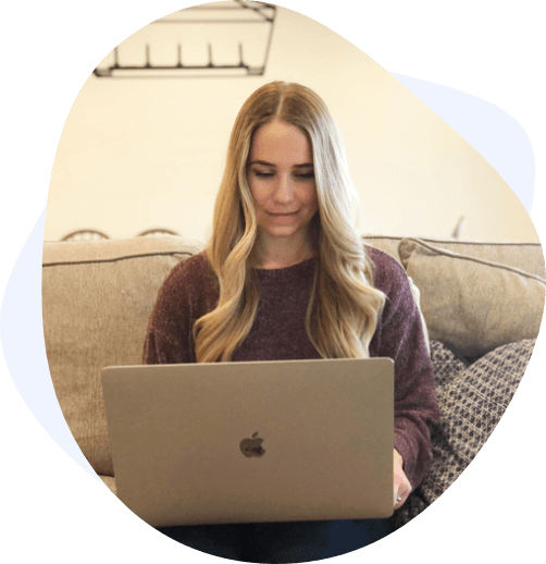 blonde woman laptop couch