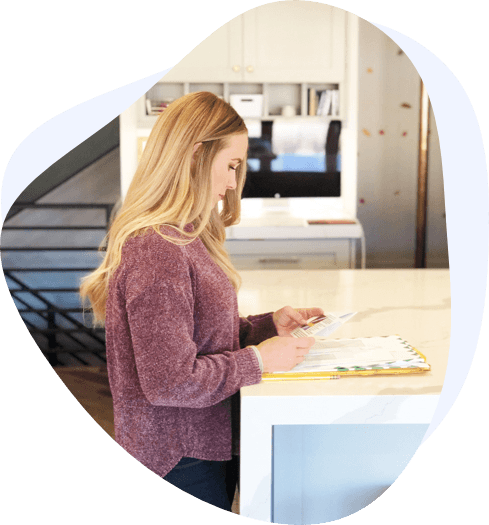 blonde woman reading mail