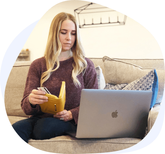 blonde woman using credit card